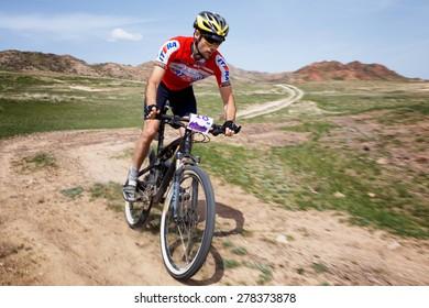 "ALMATY, KAZAKHSTAN - MAY 1, 2015: M.Balanenko (N18) in action at Adventure mountain bike marathon ""Jeyran Trophy 2015"""