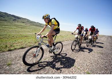 "ALMATY, KAZAKHSTAN - MAY 1: Dmitry Rakhimkulov in action at Adventure mountain bike cross-country marathon in desert ""Jeyran Trophy 09"" May 1, 2009 in Almaty, Kazakhstan."