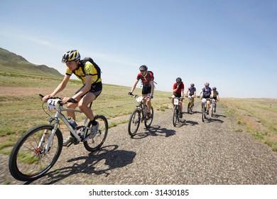 "ALMATY, KAZAKHSTAN - MAY 1: Dmitry Rakhimkulov (N21) in action at Adventure mountain bike cross-country marathon in desert ""Jeyran Trophy 09"" May 1, 2009 in Almaty, Kazakhstan."