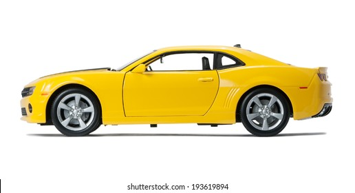 Almaty, Kazakhstan - May 14, 2014: New yellow model Chevrolet Camaro sports isolated on a white background with shadow.