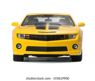 Almaty, Kazakhstan - May 14, 2014: New yellow model Chevrolet Camaro sports isolated on a white background with shadow, front view.