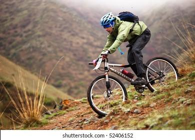 "ALMATY, KAZAKHSTAN - MAY 2: I.Popov (N22) in action at Adventure mountain bike cross-country marathon in mountains ""Jeyran Trophy 2010"" May 2, 2010 in Almaty, Kazakhstan."