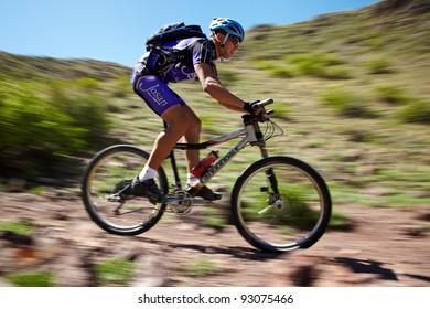 "ALMATY, KAZAKHSTAN - MAY 2: I.Popov (N5) in action at Adventure mountain bike cross-country marathon in mountains ""Jeyran Trophy 2011"" on May 2, 2011 in Almaty, Kazakhstan."
