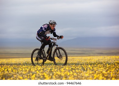 """ALMATY, KAZAKHSTAN - MAY 2: M.Kolbasov (N24) and others in action at Adventure mountain bike cross-country marathon in mountains """"Jeyran Trophy 2010"""" May 2, 2010 in Almaty, Kazakhstan."""