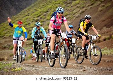 "ALMATY, KAZAKHSTAN - MAY 2: Mountain bikers in action at Adventure mountain bike cross-country marathon ""Jeyran Trophy 2010,"" on May 2, 2010 in Almaty, Kazakhstan."