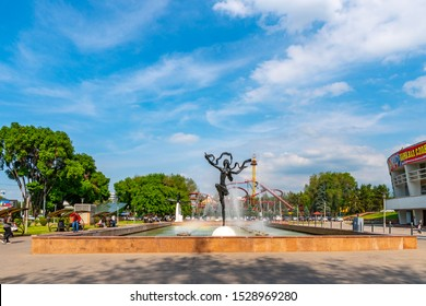 ALMATY, KAZAKHSTAN - MAY 2019: Kazakh State Circus Frontal View of a Dancing Woman Statue at a Fountain on a Sunny Blue Sky Day