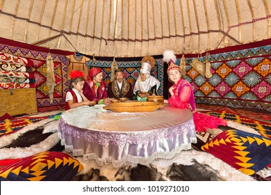ALMATY, KAZAKHSTAN - MAY 31, 2017: Kazakh people in traditional costumes in a nomadic tent known as yurt, in Almaty, Kazakhstan.