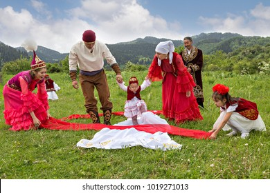 ALMATY, KAZAKHSTAN - MAY 31, 2017: Kazakh people show local tradition of Tusau Kesu which symbolizes a ceremony that accompanies first steps of a child, in Almaty, Kazakhstan.