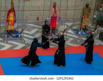 Almaty, Kazakhstan - Oct 7, 2017: Day of Japan Culture in Kazakh Museum. Four actors in samurai suits performing Kendo (fencing with bamboo sticks). Selective focus