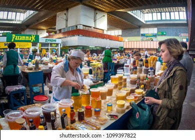 ALMATY, KAZAKHSTAN - OCTOBER 17, 2014 : Honey stall in Zelyony Bazaar also known as Green Bazaar the typical market of Kazakhstan capital city.