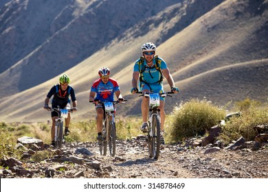 """ALMATY, KAZAKHSTAN - SEP 06, 2015: V.Vinokurov (N5) and others in action at Adventure mountain bike cross-country competition in mountains """"Bartogay Marathon 2015"""""""