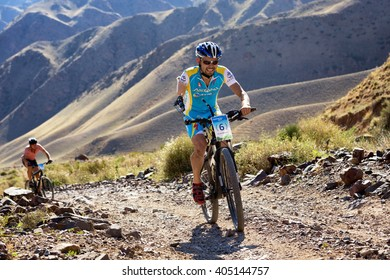 """ALMATY, KAZAKHSTAN - SEP 06, 2015: I.Makhmutov (N6) - athlete with physical disabilities in action at Adventure mountain bike cross-country competition in mountains """"Bartogay Marathon 2015"""""""