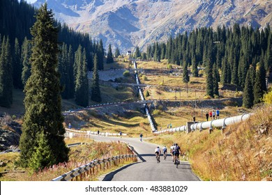 ALMATY, KAZAKHSTAN - SEP 10, 2016: Bikers and runners up the road and pipeline to the Big Almaty Lake, Tien Shan Mountains