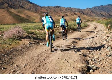 "ALMATY, KAZAKHSTAN - SEPTEMBER 04, 2011: Competitors in uniform Team Astana  in action at Adventure mountain bike cross-country marathon in mountains ""Marathon Bartogay-Assy-Batan 2011"""