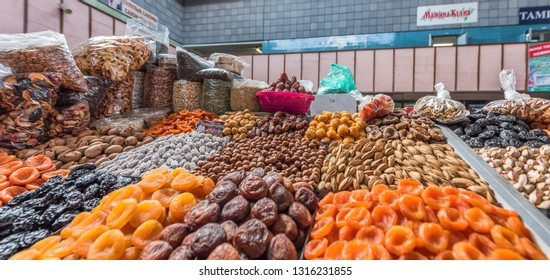 Almaty, Kazakhstan - September 2017: dried fruits and buts on sale at the famous city Green Bazaar