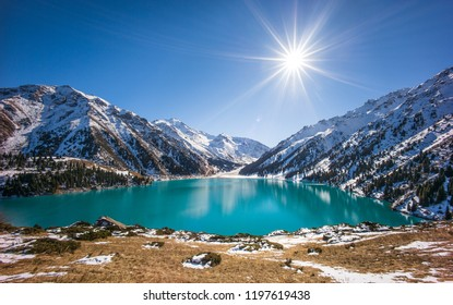 ALMATY, KAZAKHSTAN: Spectacular scenic Big Almaty Lake ,Tien Shan Mountains in Almaty, Kazakhstan during late autumn, winter.