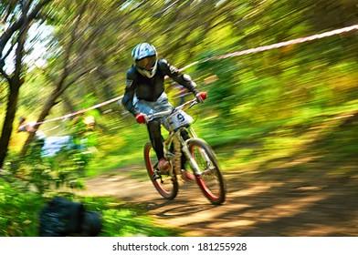 "ALMATY, KAZAKSTAN - AUGUST 03: P.Rezaev (N9)  in action at Mountain Bike sports event Superiority of ""Cycling club named A.Vinokurov"" Downhill in Almaty, Kazakstan Aug 03, 2013."