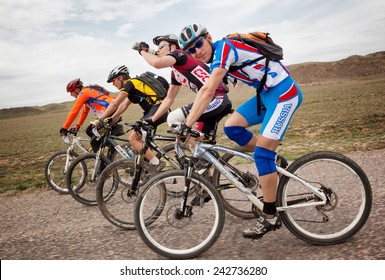 """ALMATY, KAZAKSTAN - MAY 01, 2010: Group of unknown riders in action at Adventure mountain bike cross-country competition in mountains """"Jeyran Trophy 2010"""""""