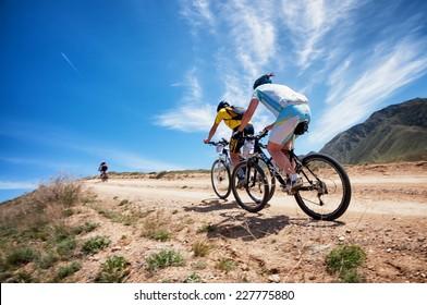 "ALMATY, KAZAKSTAN - MAY 01, 2014: Unidentified bikers in action at Adventure mountain bike cross-country marathon in mountains ""Jeyran Trophy 2014"""