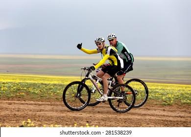"ALMATY, KAZAKSTAN - MAY 02, 2015: V.Ganga (N9,first) in action at Adventure mountain bike cross-country marathon in mountains ""Jeyran Trophy 2015"""