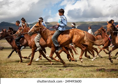 ALMATY REGION, KAZAKHSTAN - AUGUST 12, 2009: Unidentified competitors in action at A traditional national nomad long-distance horse riding competition Bayga in valley Assy.