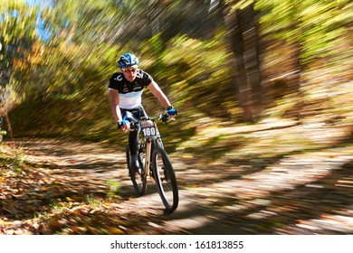 "ALMATY REGION, KAZAKHSTAN - OCTOBER 13: N.Tlegenov (N169) in action at mountain bike sports event ""Red Bull Mountain Rage"" October 13, 2013 in Almaty region, Kazakhstan."