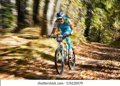 "ALMATY REGION, KAZAKHSTAN - OCTOBER 13: Y.Shkerdin (N193) in action at mountain bike sports event ""Red Bull Mountain Rage"" October 13, 2013 in Almaty region, Kazakhstan."