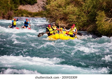 ALMATY REGION, KAZAKSTAN - JUNE 07, 2014: Athletes training on rafts and children ride on the river Chilik