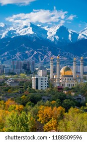 Almaty/Kazakhstan - Sep 2018: The modern mosque with golden domes in front of mountains in good weather in the autumn city.