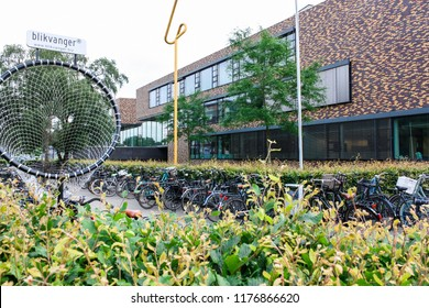 Almelo, Nederland. June, 2018. High school in a small town. European education. Exterior of the educational institution. Lots of bicycles are around.