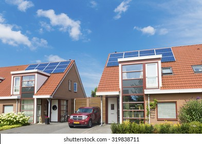 ALMELO, NETHERLANDS - AUGUST 8, 2015: modern residential houses with solar panels on the roof