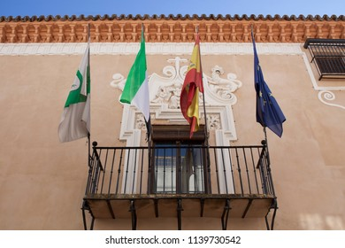 Almendralejo, Spain. January 26th, 2018: Town Hall Building former Palace of Monsalud, Almendralejo, Badajoz, Spain. Balcony with flags