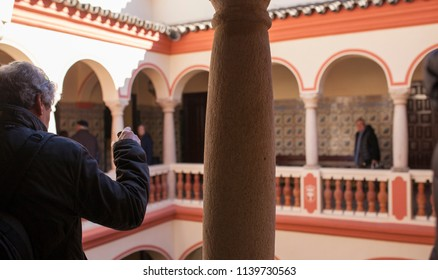 Almendralejo, Spain. January 26th, 2018: Town Hall Building former Palace of Monsalud, Almendralejo, Badajoz, Spain. Visitor on upper floor courtyard