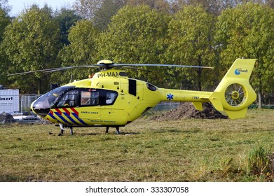 Almere, Flevoland, The Netherlands - October 30, 2015: Dutch Ambulance Helicopter (Lifeliner 1) stands at rest on a grass field in Almere Stad ('t Oor)