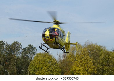 Almere, Flevoland, The Netherlands - October 30, 2015: Dutch Ambulance Helicopter (Lifeliner 1) approaching for landing in the city of Almere Stad ('t Oor)
