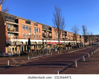 Almere Haven, Flevoland, the Netherlands - February 15, 2019: Apartment building and restaurants in city of Almere Haven (Sluidkade).