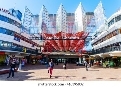 Almere, Netherlands - April 19, 2016: railway station of Almere with unidentified people. Almere is a fast growing, planned city. With a population of about 200,000 it is the 7th largest Dutch city