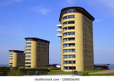 Almere, the Netherlands - April 5, 2019: Apartment buildings Muiderburght against a blue sky in the city of Almere.