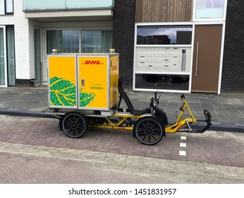 Almere, the Netherlands - July 15, 2019: DHL inner-city Electric Delivery Cargo Bike parking on a public parking lot.