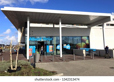 Almere, the Netherlands - March 18, 2019: Grocery shop entrance Albert Heijn Almere Poort. Albert Heijn or AH, is the largest supermarket chain in the Netherlands.