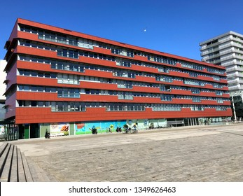 Almere, the Netherlands - March 24, 2018:  Apartment building The City against a blue sky in the city of Almere.