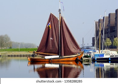 Almere, the Netherlands - March 29, 2019: Traditional wooden visser ship in the harbor of Almere Haven.