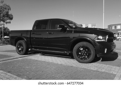 Almere, The Netherlands - May 25, 2017: Black Dodge Ram pick up parked in a public parking lot in the city of Almere.