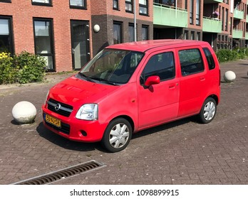 Almere, Netherlands - May 26, 2018: Red Opel Agila parked by the side of the road.
