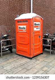 Almere, The Netherlands - November 23, 2018: Boels rental bio-toilet on a public road in the city of Almere