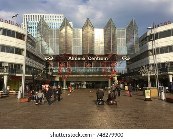 Almere, The Netherlands-  November 3, 2017: Railway station Almere Centrum with unidentified people against a cloudy sky. Almere is the fastest growing (planned) city of the Netherlands