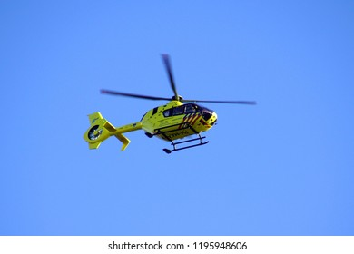 Almere, Netherlands - October 5, 2018: Dutch Ambulance Helicopter (Lifeliner 1) flying by against a clear blue sky.