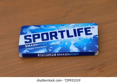 Almere, The Netherlands - October 8, 2017: Sportlife Extramint Suger Free Chewing Gum package against a wooden background.