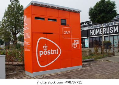 Almere, The Netherlands - Oktober 15 2016: PostNL parcel and letter machine (pakketautomaat) by the side of a public road in the city of Almere.