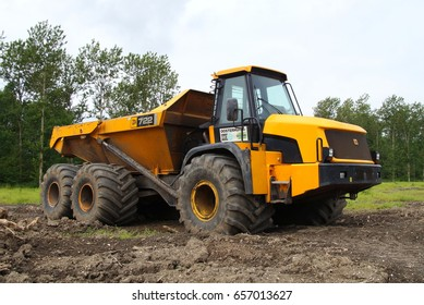 Almere Poort, Flevoland, The Netherlands - June 10, 2017: Yellow JCB 722 Articulated Dump Truck parked on a construction site in the city of Almere. Nobody in the dumper.